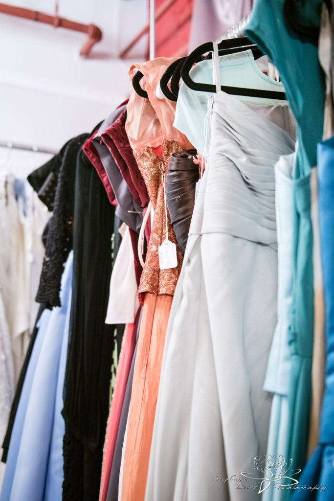 prom dresses lined up on rack in store
