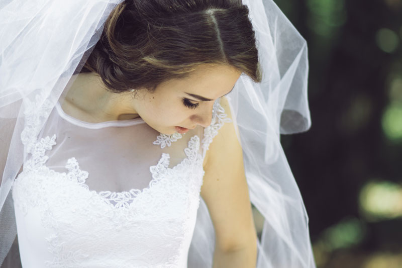 bride wearing dress and veil